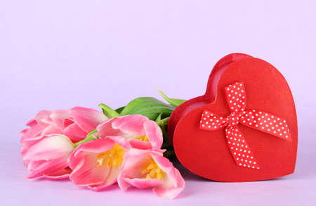 Pink tulips and gift box, on color background Stock Photo - 18138373