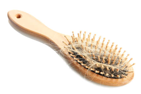 pressure loss: comb brush with lost hair, isolated on white