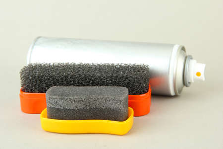 Set of stuff for cleaning and polish shoes, on color background Stock Photo - 18185893