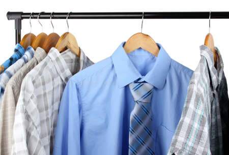 Shirts with ties on wooden hangers isolated on white Stock Photo - 18185646