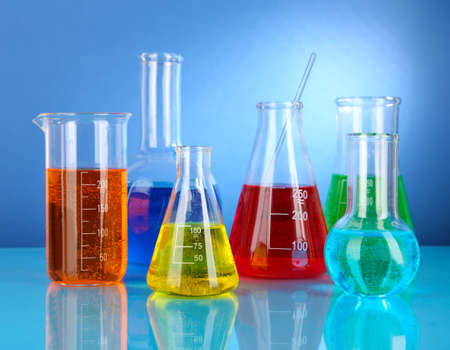 Test tubes with colorful liquids on blue background Stock Photo - 18185848
