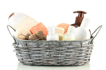 Composition of cosmetic bottles and soap in basket, isolated on white Stock Photo - 18185797