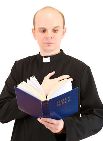 reverent: Priest with Holly Bible, isolated on white