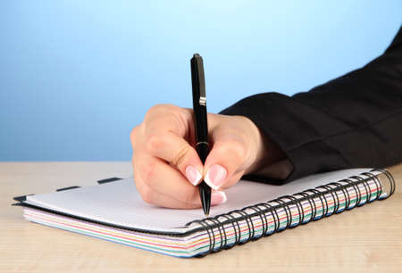 Hand write on notebook, on color background photo