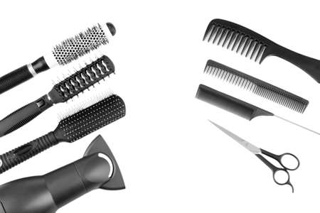 Comb brushes, hairdryer and cutting shears, isolated on white Stock Photo - 18239156