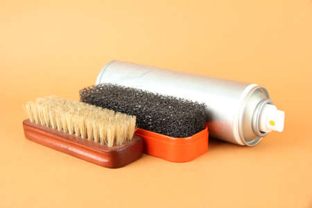 Set of stuff for cleaning and polish shoes, on color background Stock Photo - 18239779