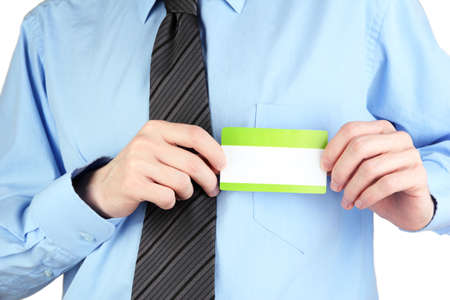 nametag: Businessman wearing blue shirt with tie and holding blank nametag close up