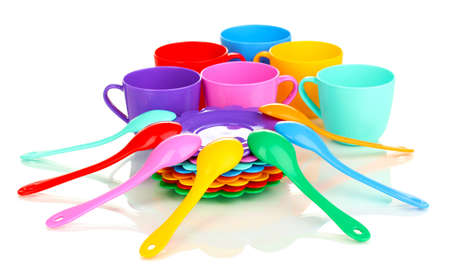 Childrens plastic tableware isolated on  white photo