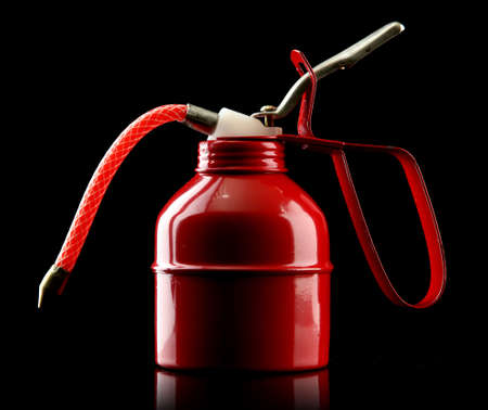 lubricator: Oil can on black background