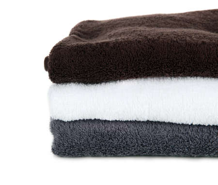 Bath towels isolated on white photo