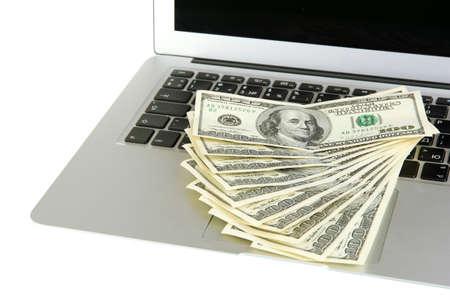 Money on laptop isolated on white Stock Photo - 18300840