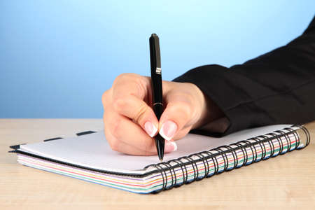 Hand write on notebook, on color background Stock Photo - 18300848