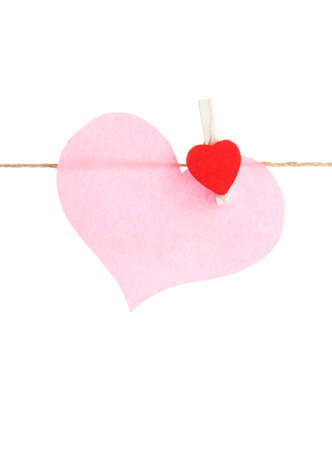 paper heart on rope, isolated on white photo
