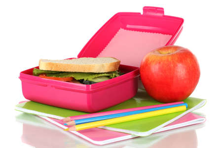 Lunch box with sandwich,apple and stationery isolated on white photo