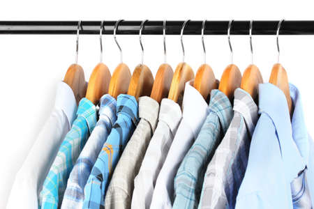 Shirts with ties on wooden hangers on light background Stock Photo - 18316196