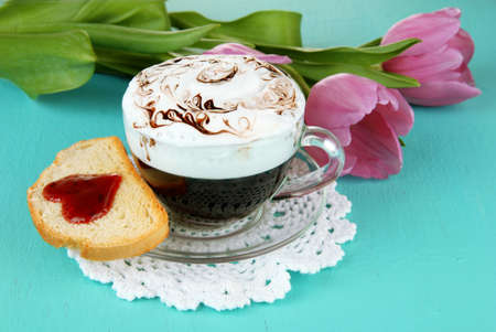 Composition of coffee, toast and tulips on color background photo