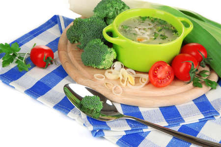 Diet soup with vegetables in pan isolated on white photo