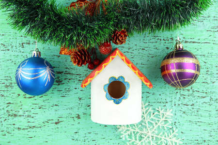 Nesting box  and Christmas decoration on blue background photo