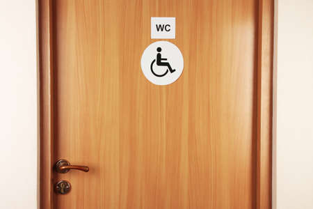 Toilet sign on wooden door photo