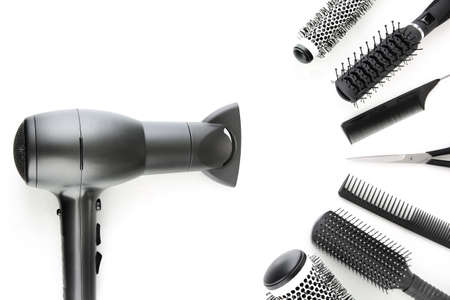 Comb brushes, hairdryer and cutting shears, isolated on white Stock Photo - 18322802