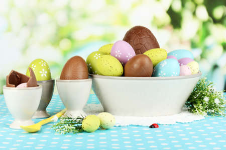 elliptic: Composition of Easter and chocolate eggs on natural background