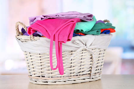 Clothes in wooden basket on table in room Stock Photo - 18323522