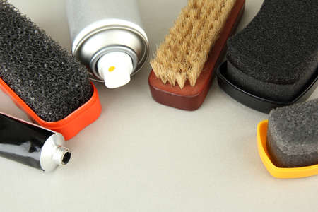 Set of stuff for cleaning and polish shoes, on color background Stock Photo - 18323537