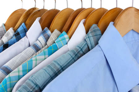 Shirts with ties on wooden hangers close-up Stock Photo - 18323393