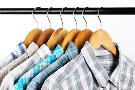Shirts with ties on wooden hangers isolated on white Stock Photo - 18323419