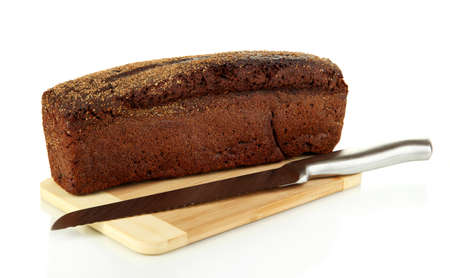 Black bread with sesame seeds and knife on wooden board isolated on white Stock Photo - 18322979