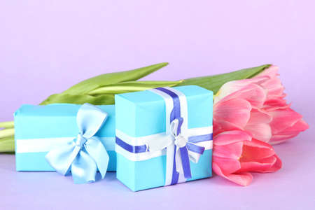 Pink tulips and gift boxes, on color background Stock Photo - 18322902