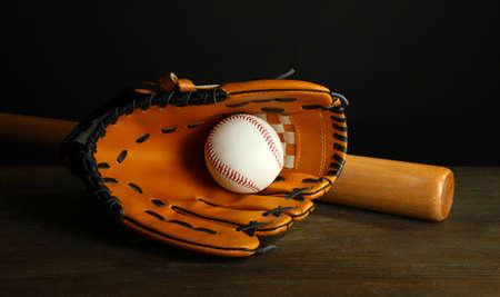 Baseball glove, bat and ball on dark background Stock Photo - 18322825