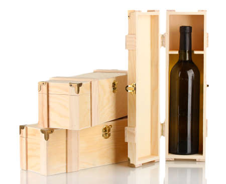Wine bottle in wooden box, isolated on white photo