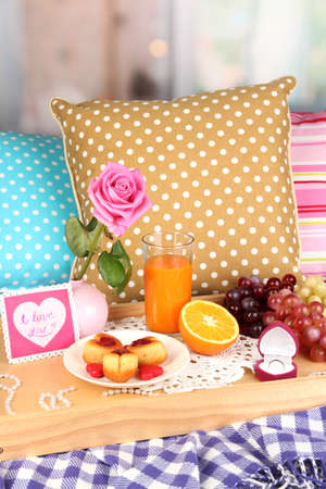 Breakfast in bed on Valentines Day on room background photo