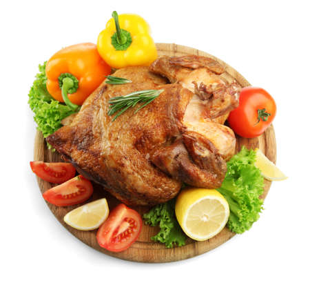 Whole roasted chicken on wooden plate with vegetables, isolated on white Stock Photo - 18472597