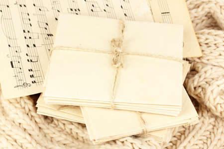 Stacks of old letters and music sheets on soft scarf photo