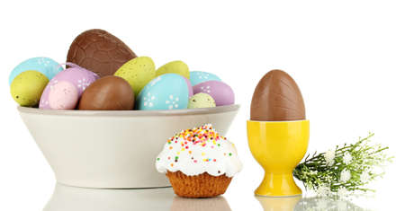 elliptic: Composition of chocolate eggs and Easter cake isolated on white