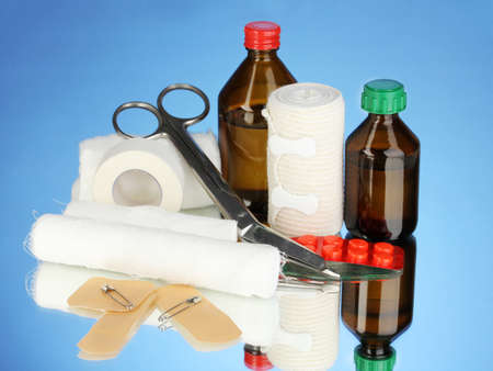 First aid kit for bandaging on blue background Stock Photo - 18472772
