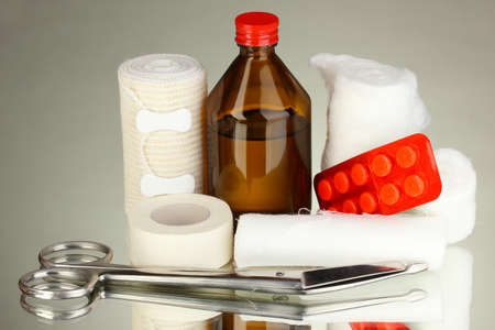 First aid kit for bandaging on grey background Stock Photo - 18472883