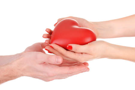 beloved: Red heart in woman and man hands, isolated on white Stock Photo