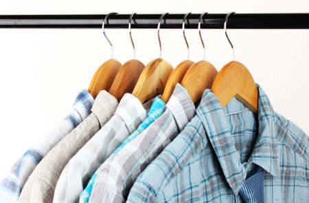Shirts with ties on wooden hangers on light background Stock Photo - 18472765