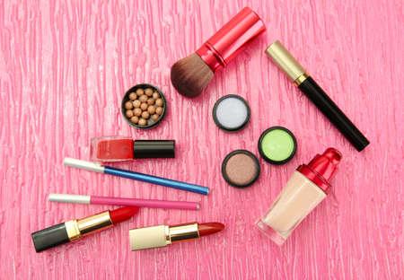 Decorative cosmetics on pink background photo