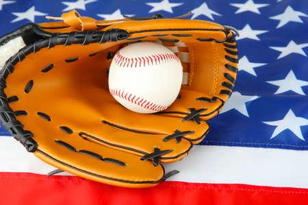 Baseball glove and ball on American flag background photo