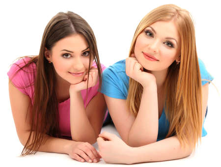 Two girl friends smiling isolated on white photo