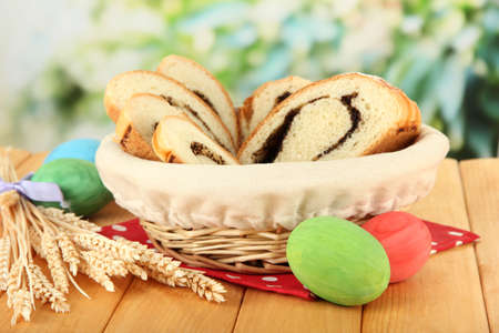 Loaf with poppy seed in wicker basket, on bright background Stock Photo - 18527013