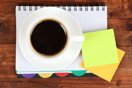 worktable: Cup of coffee on worktable close up
