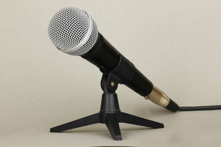 Microphone on grey background photo
