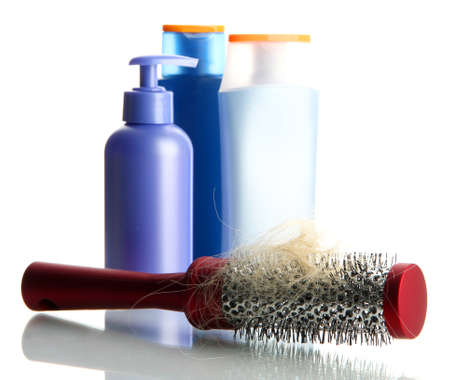 chemo: comb brush with lost hair and cosmetics bottles, isolated on white