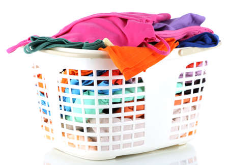 Clothes in plastic basket isolated on white photo