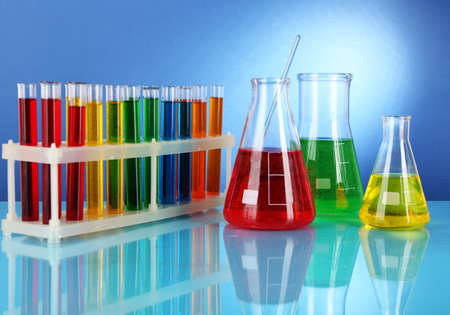 Test tubes with colorful liquids on blue background Stock Photo - 18575355